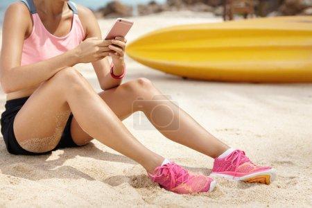 athletic woman on sandy beach