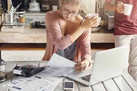 woman dressed casually calculating bills
