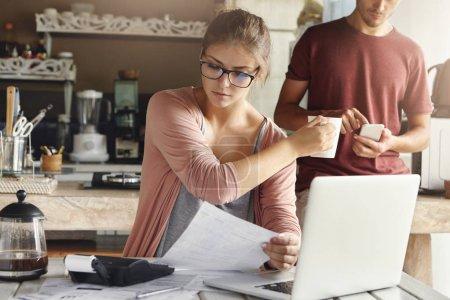 woman doing home budget