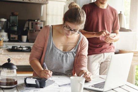 woman managing taxes and calculating bills