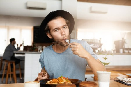 man enjoying tasty food