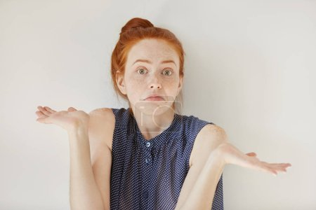 clueless redhead woman with arms out