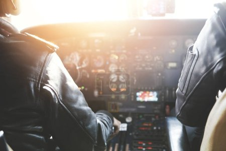 Captain and copilot sitting inside aircraft