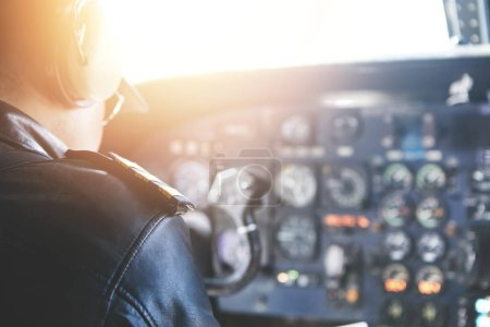 commercial pilot wearing headset