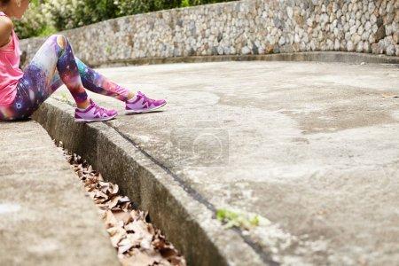 woman runner wearing space print leggings