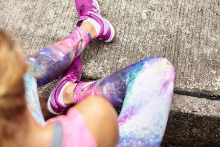 female athlete in stylish leggings