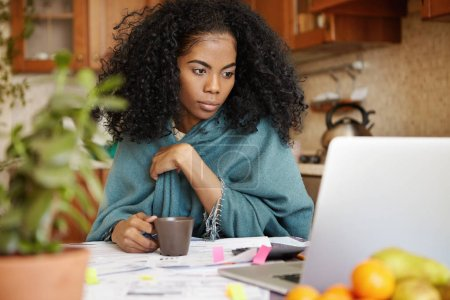 African female doing paperwork at home