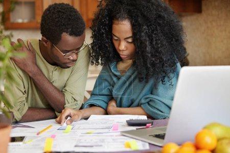 couple analyzing family budget