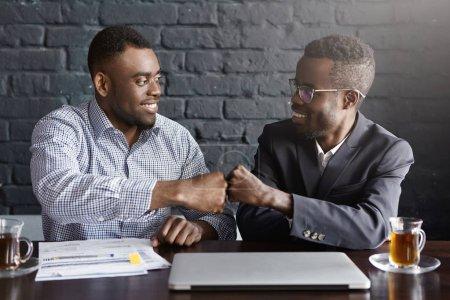 dark-skinned business people