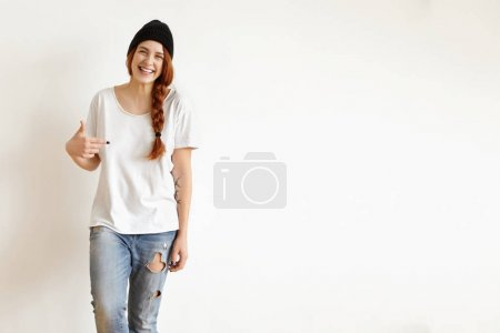 redhead hipster girl wearing black hat
