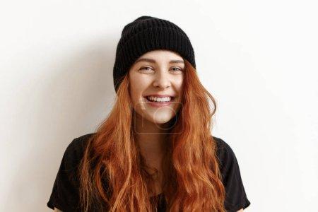 girl looking and smiling at camera