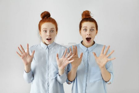 redhead girls screaming with shock and surprise