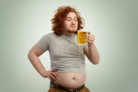 man enjoying smell of cold frothy lager