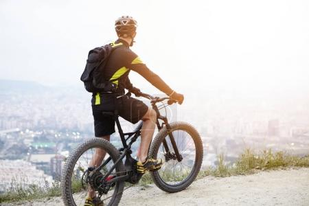 biker on mountain electric bicycle