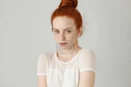 girl with hair knot and freckles