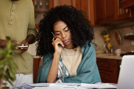 female with Afro hairstyle having phone conversation