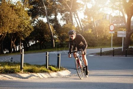 cyclist speeding on his racing bike