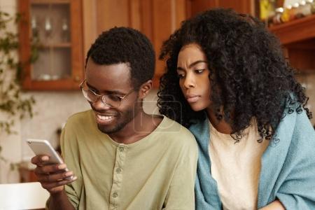 female looking over husband's shoulder