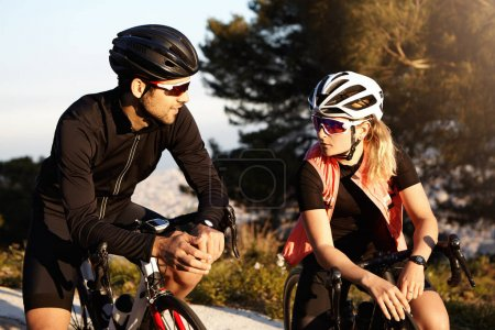 Male and female cyclists having conversation