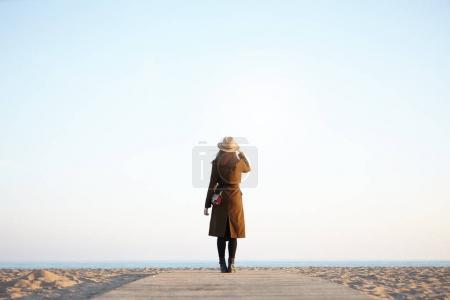 woman traveler enjoying view of calm sea