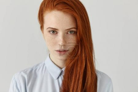 red-haired female with perfect clean freckled skin