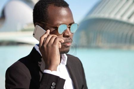 Afro American businessman checking voicemail