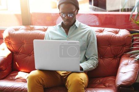 dark-skinned businessman using laptop