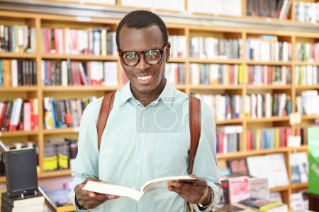 black man standing in library
