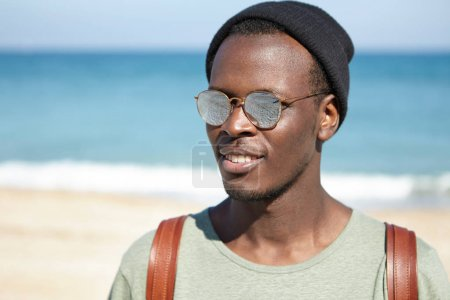 cheerful black man traveler by sea