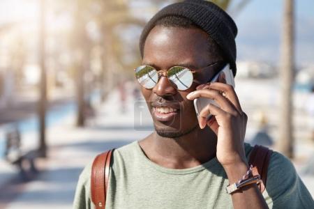 black male student having phone conversation