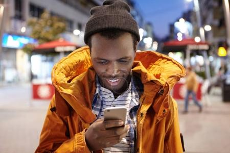 black man typing text message