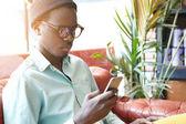 dark-skinned European man on electronic gadget