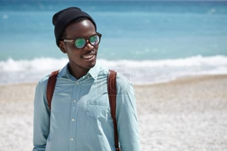 Afro American male student by the sea