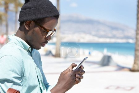African man using electronic device