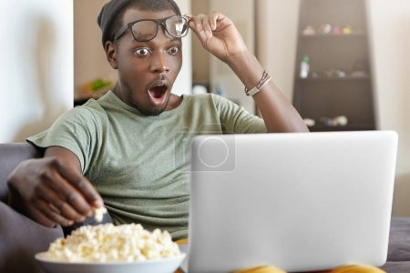 Afro American male watching detective series