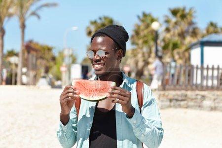 black student holding watermelon