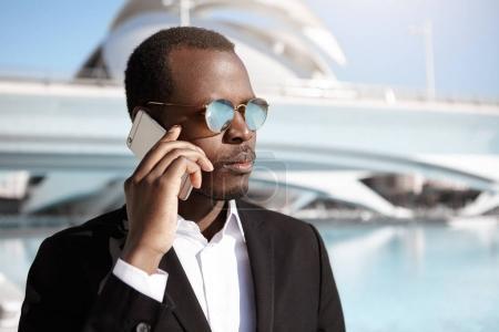 Confident young black European businessman