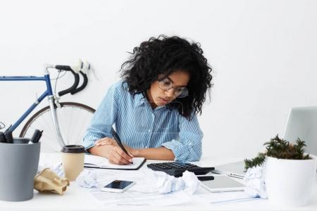 female columnist suffering from writer's block