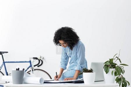 female architect holding pen