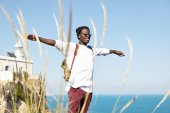 dark-skinned tourist outstretching