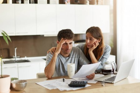 couple calculating family budget