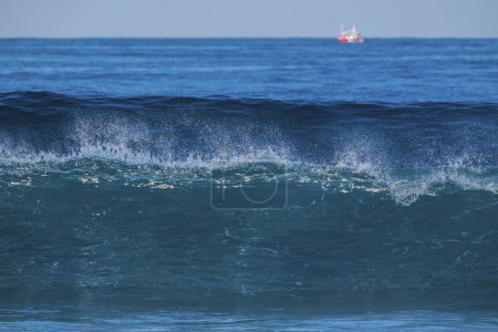 big beautiful blue wave for surfer. ocean of tenerife with power and wild water