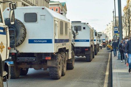 Column of police trucks for arresting people driving along Tverskaya street