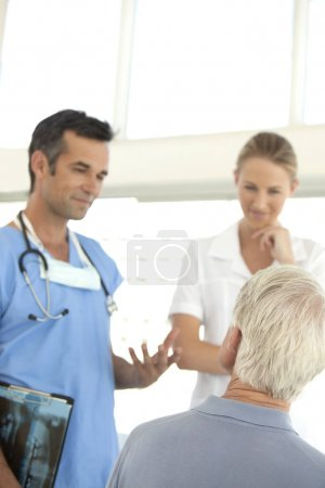 Doctor and Nurse visiting a senior Patient