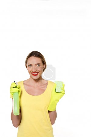 Happy woman with cleaning products