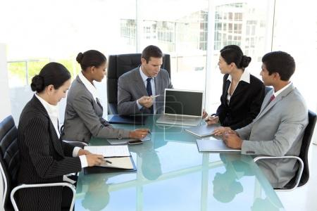 Multi-ethnic business people at a meeting