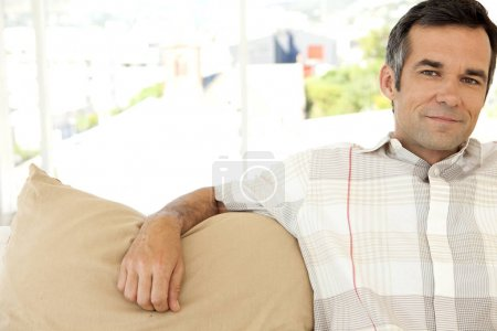 Middle aged man relaxing at home