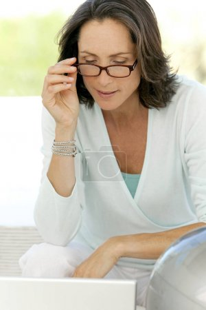 Woman wearing reading glasses