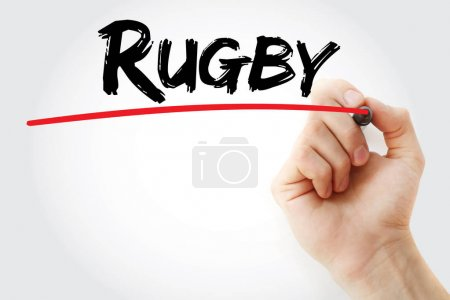 Hand writing Rugby with marker
