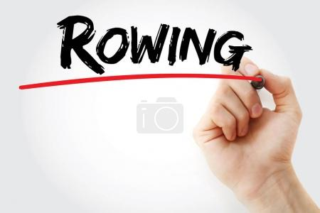 Hand writing Rowing with marker